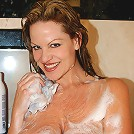 Kelly washes her big 34FF natural tits!