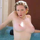 Hot horny redhead with natural hard big knockers goes in the whirlpool to expose her pussy