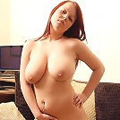 Busty redhead posing in the nude
